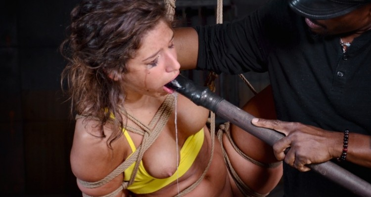Abella Danger gagging on a wooden stick