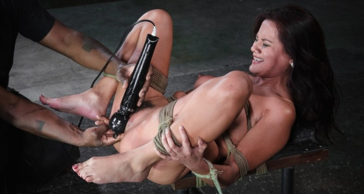 Selma Sins is brought to orgasm while tied down